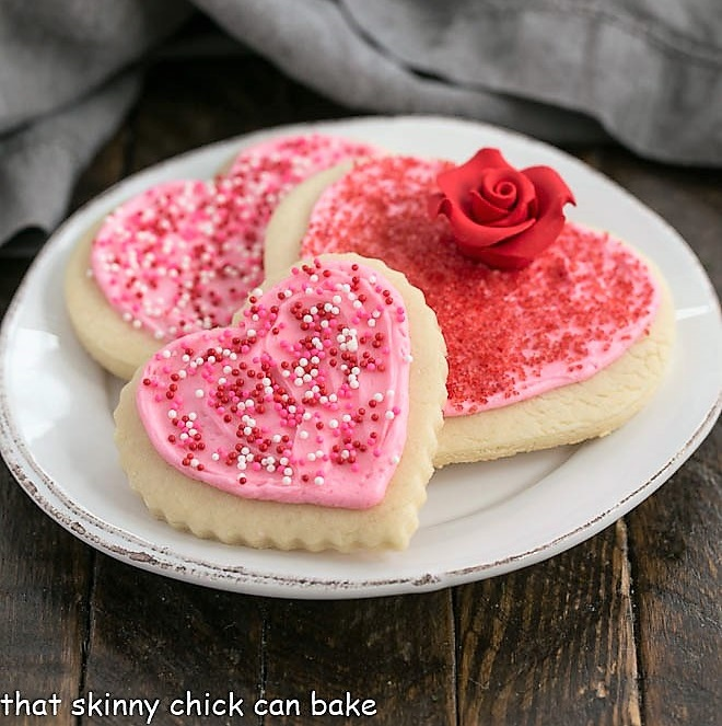 3 heart lofthouse cookies on a white plate