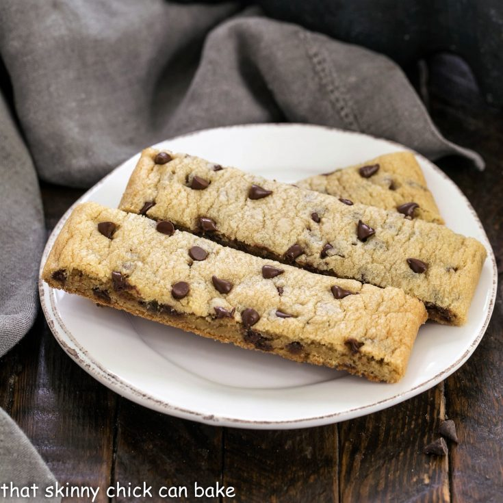 3 chocolate chip cookie sticks on a small white plate