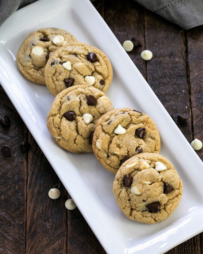 Overhead view of soft chocolate chip cookies on a white tray