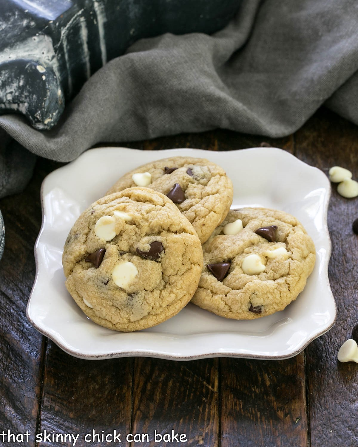 3 chocolate chip cookies with pudding on a square white plate