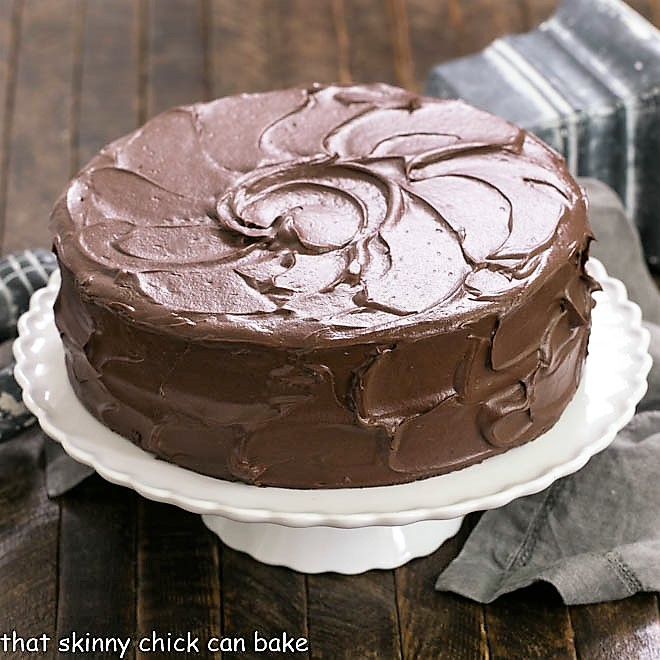 Devil's food cake on a white cake stand