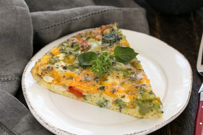 Roasted Broccoli Frittata slice on a round white plate