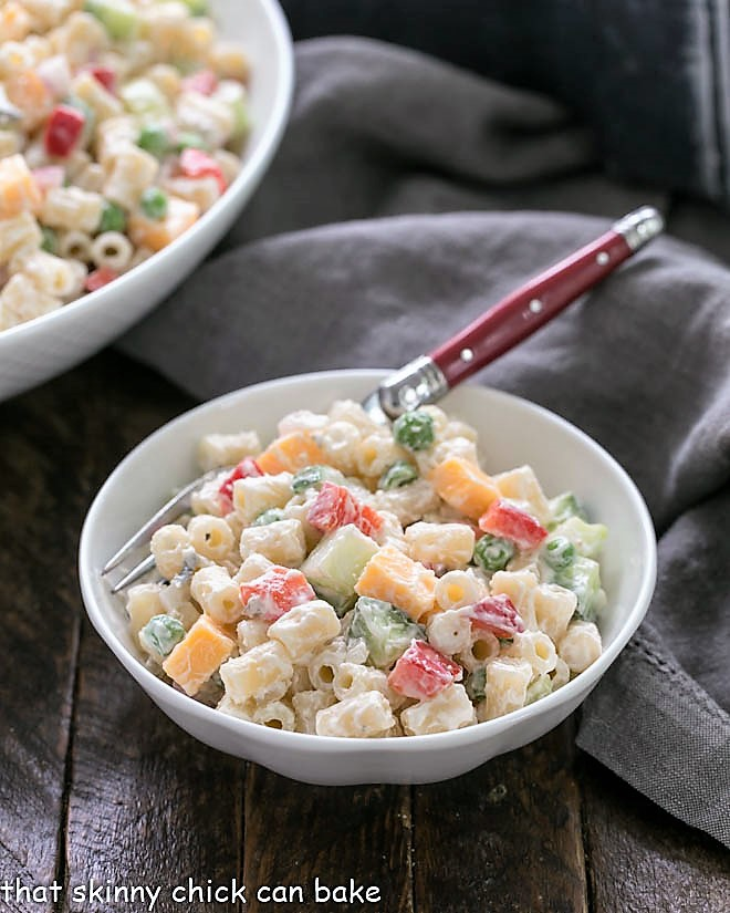 Easy pasta salad recipe in a small white bow with a red handled fork