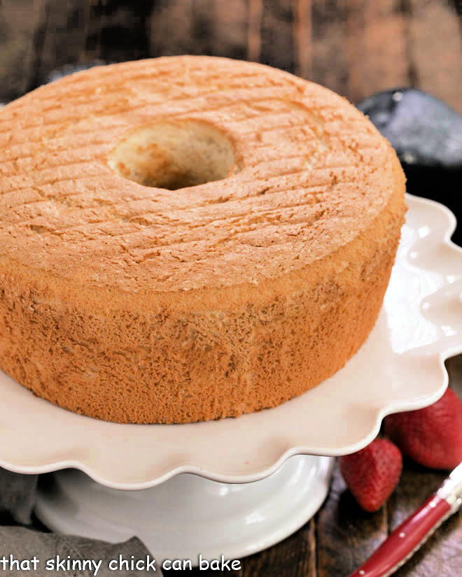 Whole angel food cake on a white cake stand