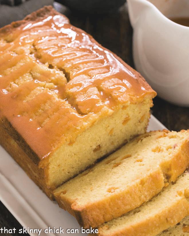 Glazed Peach Pound Cake sliced on a white tray