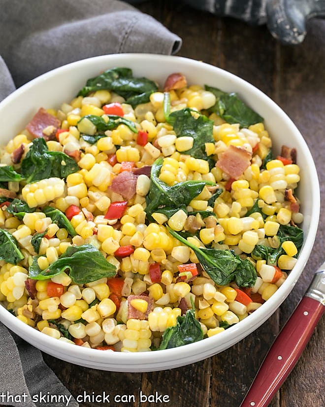 Overhead view of skillet corn in a white bowl