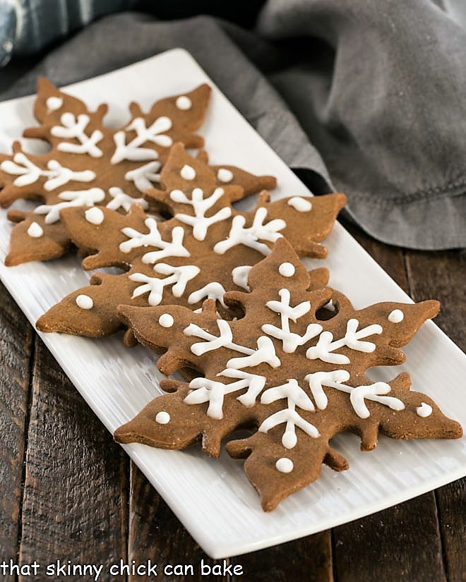 3 gingergread snowflakes on a white platter