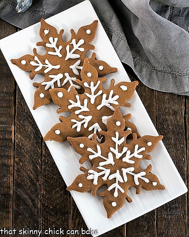 Overhead view of 3 gingerbread snow flakes