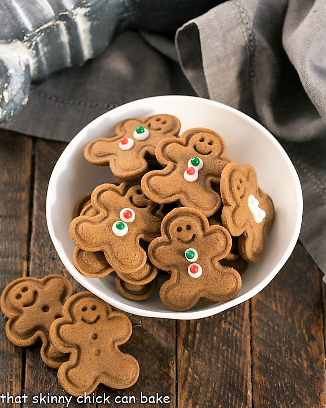 Mini gingerbread men cookies in a small white bowl