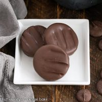 Overhead view of 3 peppermint patties on a square white plate