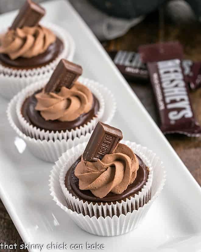 White tray of mini chocolate cheesecakes