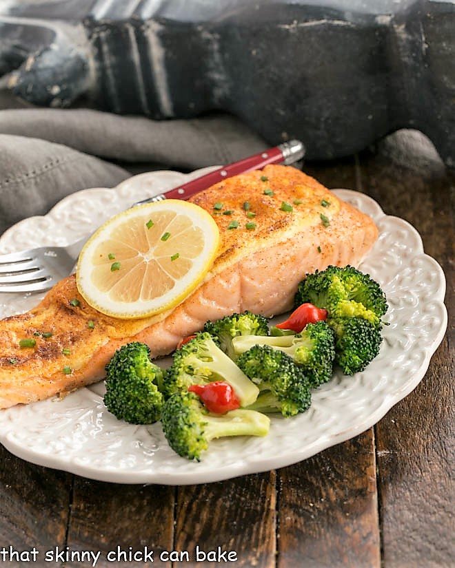 roast salmon with Dijon Mayonnasie sauce on a white plate with broccoli