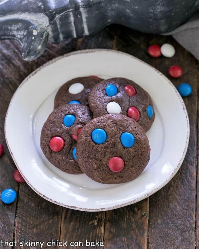 4 patriotic brownie cookies on a round white plate