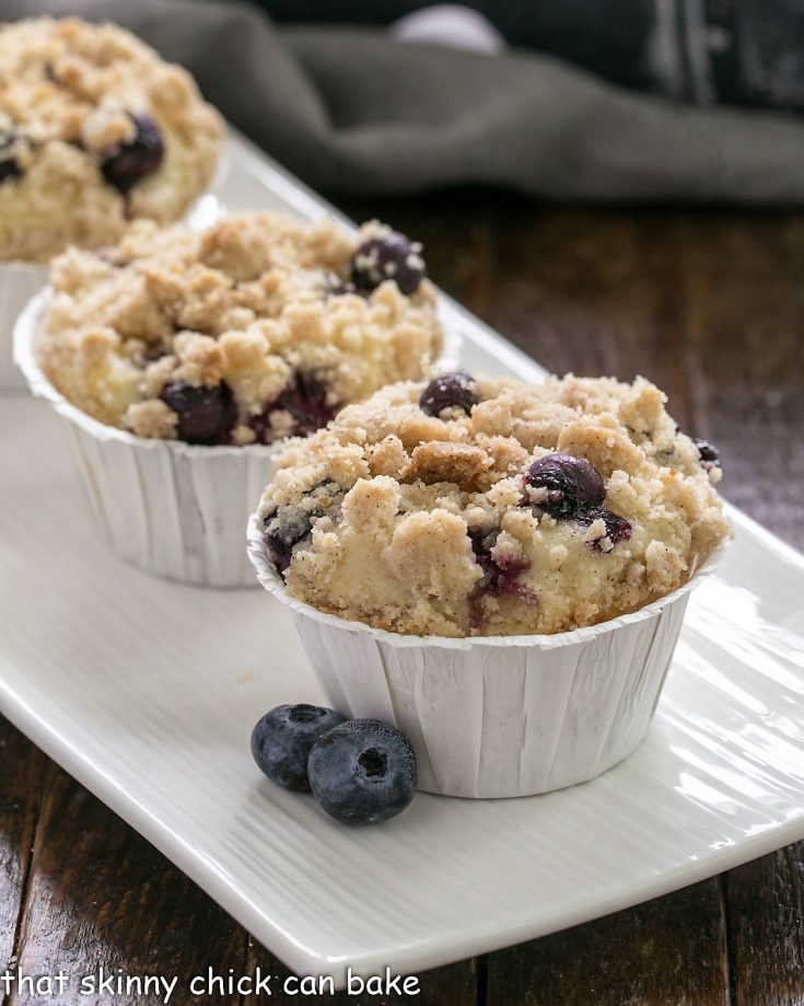 Blueberry Cream Cheese Muffins on a white ceramic tray