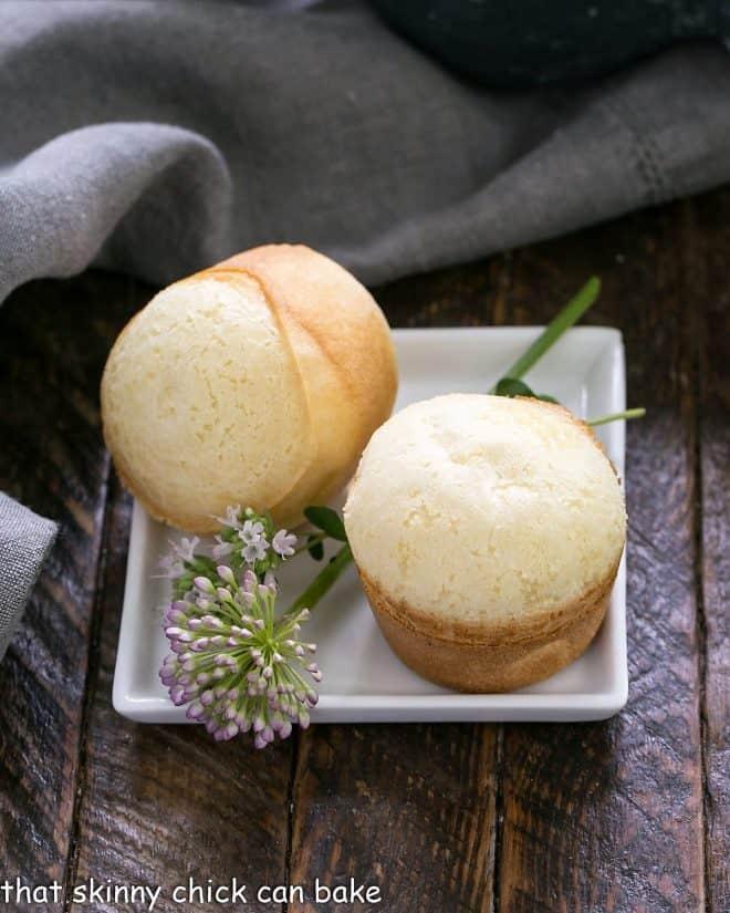 2 Brazilian Cheese Bread on a square white plate