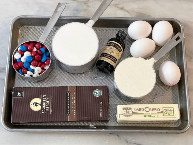 Brownie Cookie Ingredients on a rimmed baking sheet