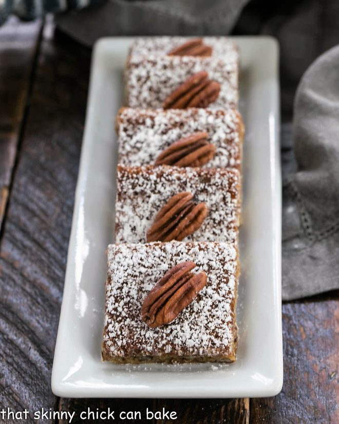 Pecan squares lined up on a white tray