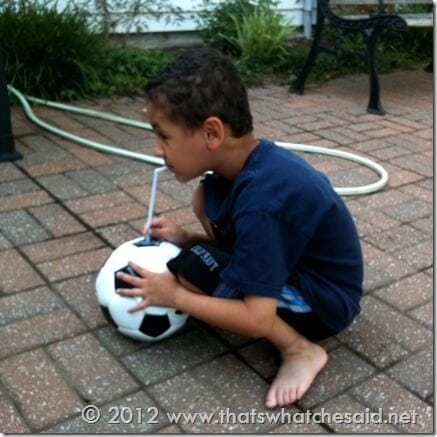 pumping up his soccer ball