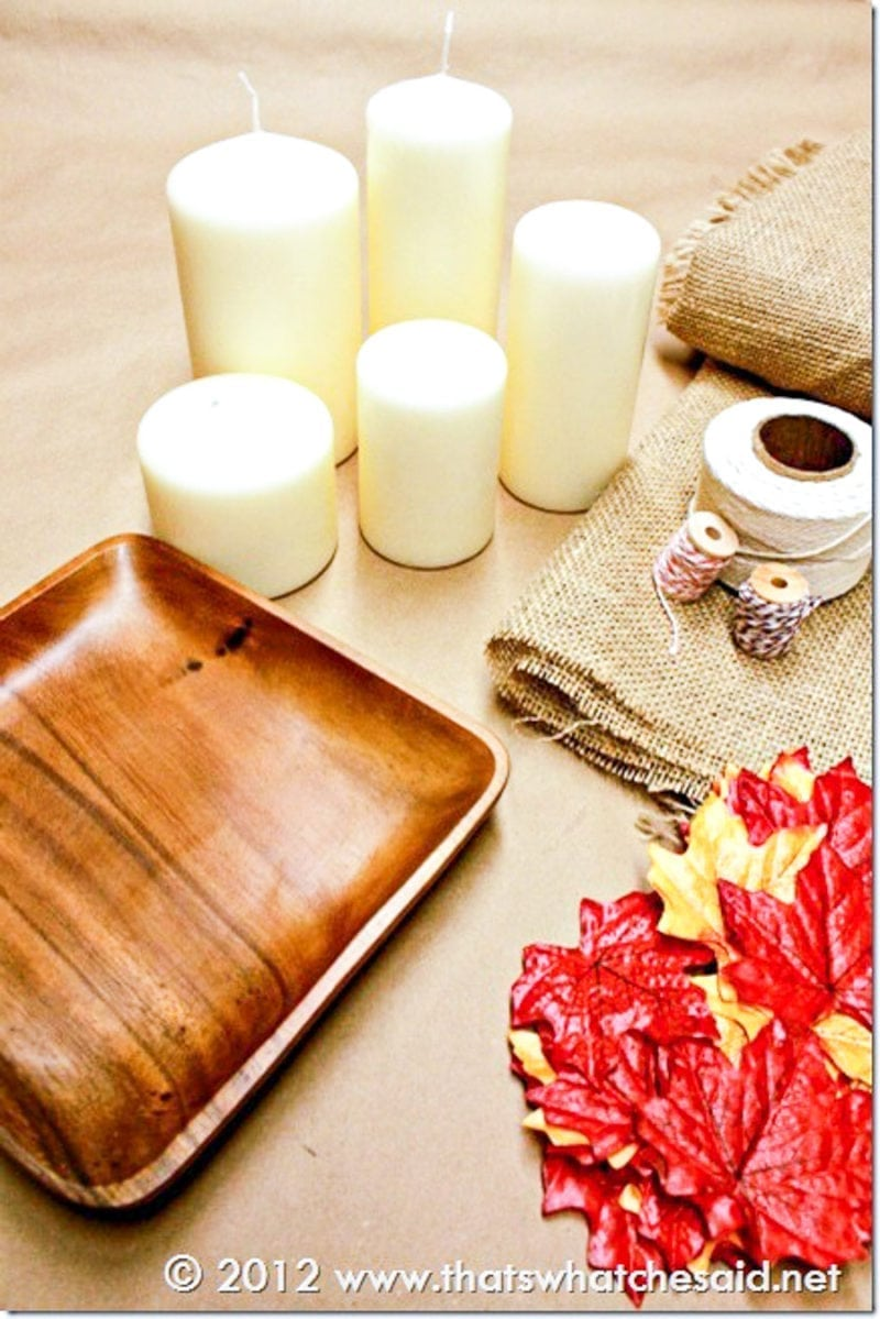 Make a Fall Candle Centerpiece with easy craft supplies: twine, fake leaves, candles and charger