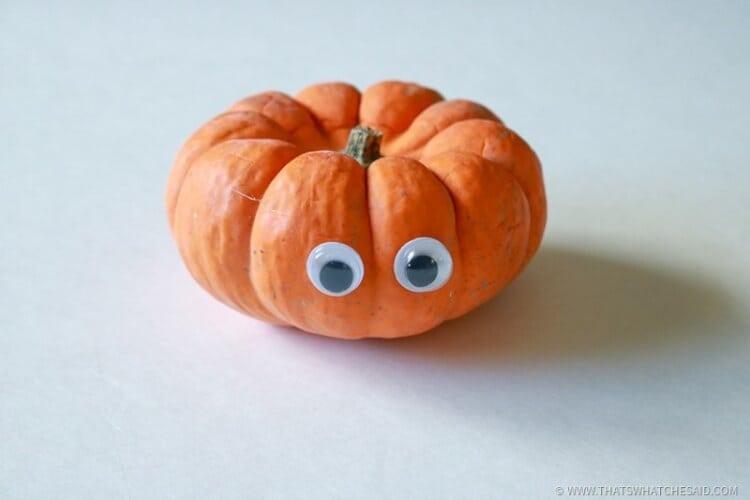 Glue Eyes onto Pumpkin
