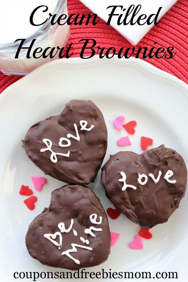 Cream filled brownies covered in chocolate with Love and Be mine written on them in white icing