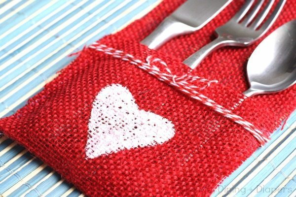 Red burlap utensil holder with painted white heart and twine