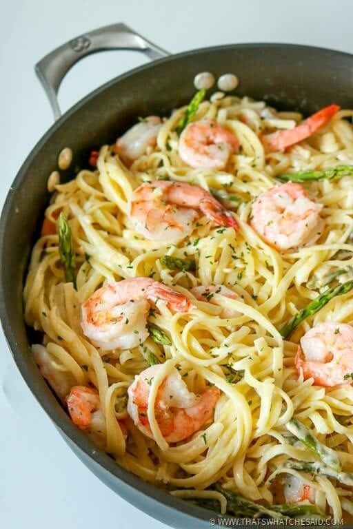 Skillet with shirmp pasta and asparagus in a white wine garlic butter sauce