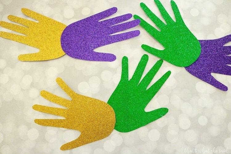 Handprint Mardi Gras Masks - Glue Handprints together to form a mask