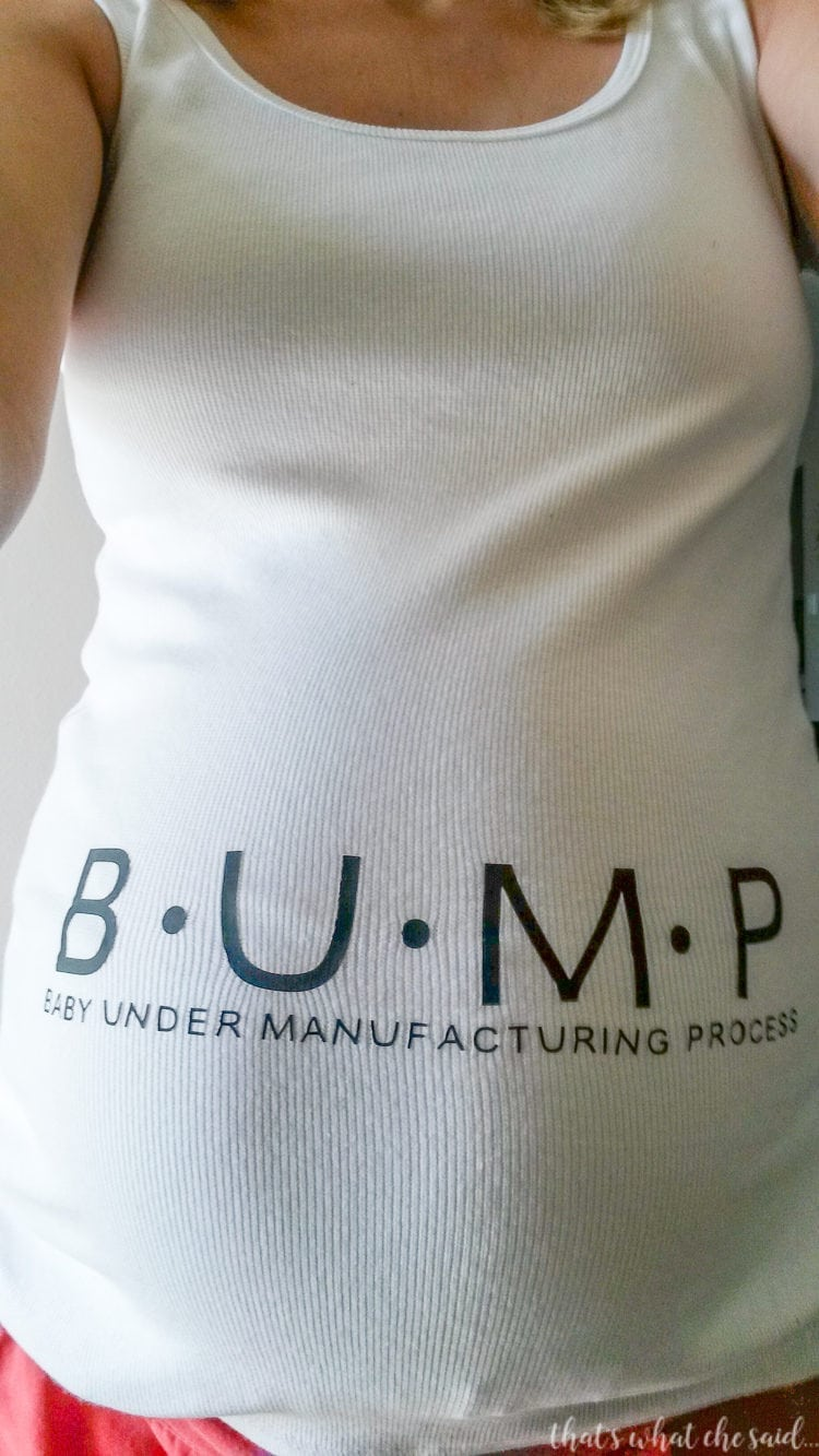 Close up of page author pregnant belly with self made maternity tank