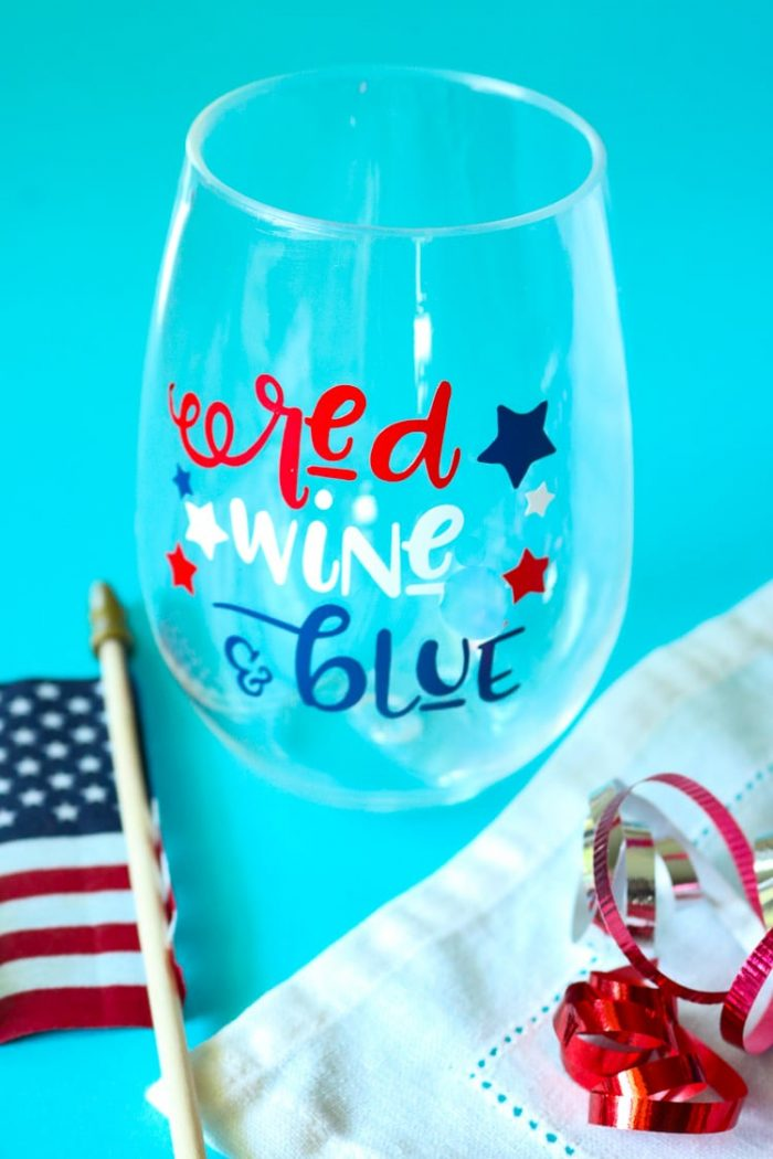 Patriotic Wine glass with American Flag and some red white and blue curling ribbon.