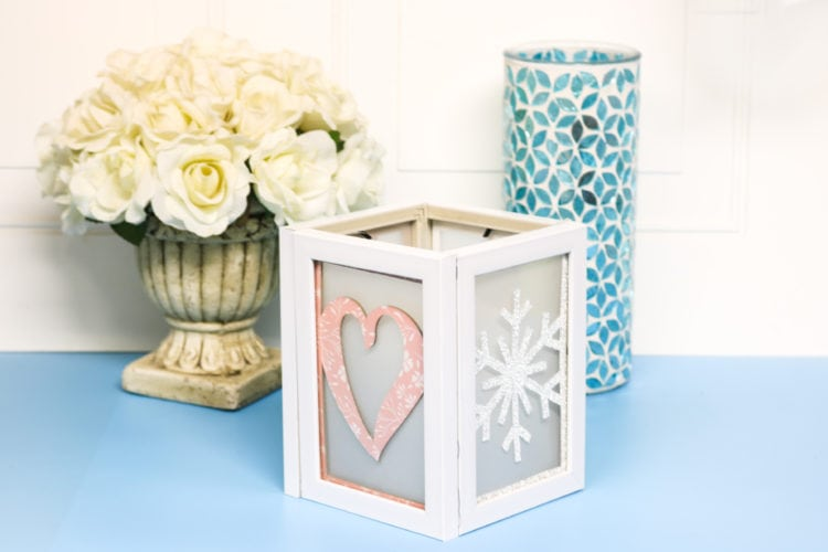 Photo frame luminary with added seasonal inserts made with the Cricut Maker