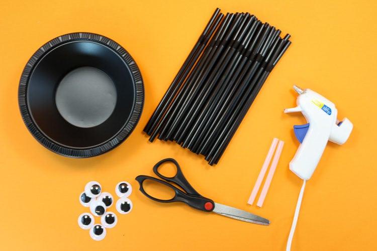 Supplies to Make Spider Treat bowls: Plastic Bowls, Straws, hot glue, googly eyes