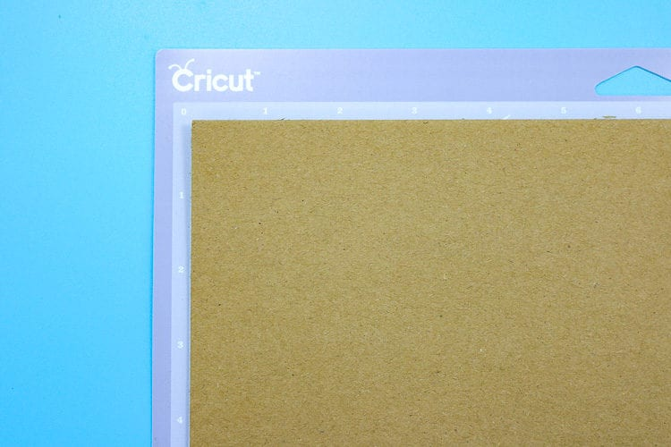 Purple Cricut Mat with Chipboard placed on it
