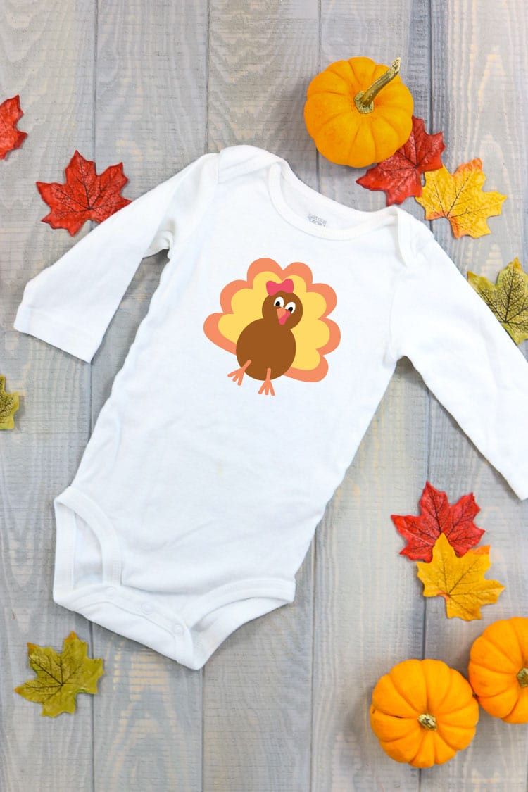 White Baby Bodysuit with Turkey on the Front. Grab the whole bundle of 7 designs to mix and match
