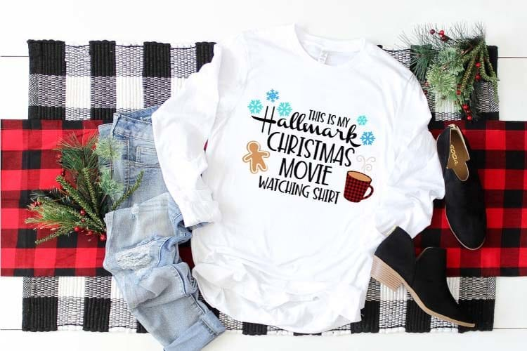 Cozy T-shirt with Hallmark Christmas Movie Watching SVG pressed on.