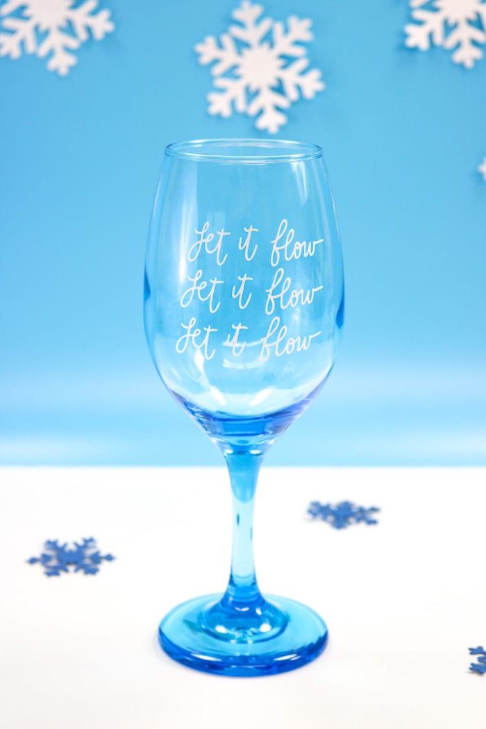 Blue Wine Glass with Let it Flow, Let it Flow, Let it Flow in Vinyl