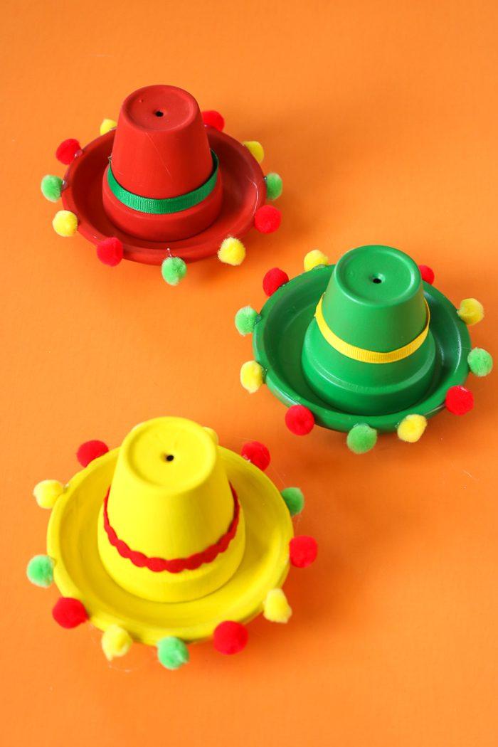 Clay garden pots decorated as Sombreros.