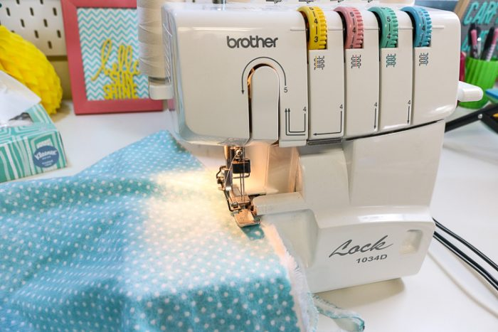 Using a Serger to finish the edges of a diy swaddle blanket.