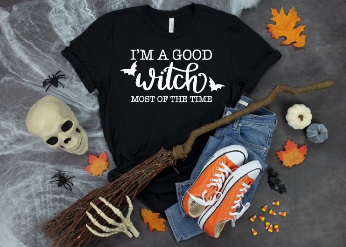 Black T-shirt with Halloween decorations around it and I'm A good Witch in Iron on