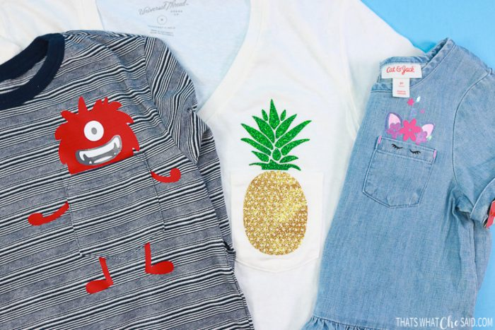 Three shirts with designs on the pockets, monster, pineapple and unicorn