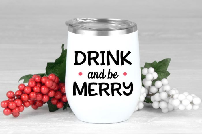"""White insulated tumbler with """"Drink and be Merry"""" saying in adhesive vinyl."""
