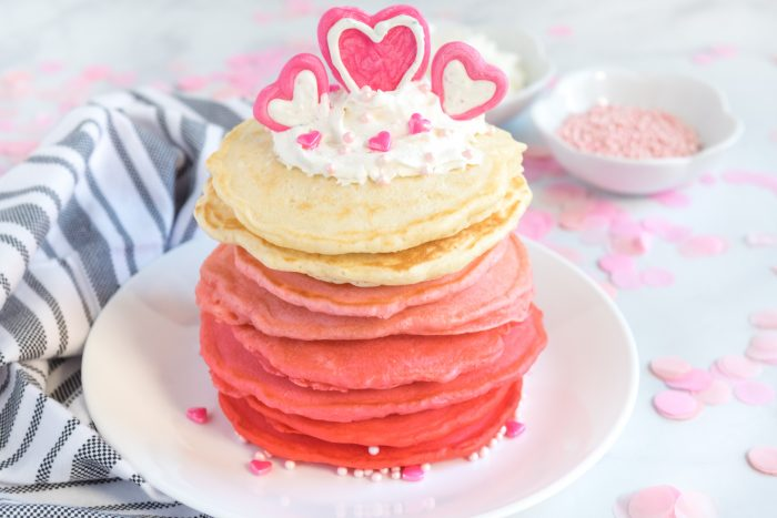 Red To Pink to white ombre pancakes with heart chocolate decoration for Valentine pancakes