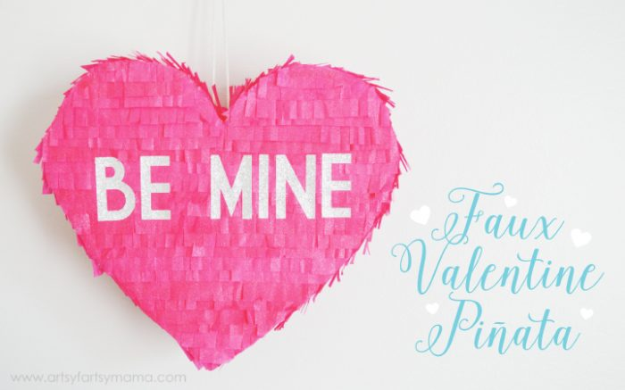 Heart Pinata made with foam board and tissue paper to look like a conversation heart