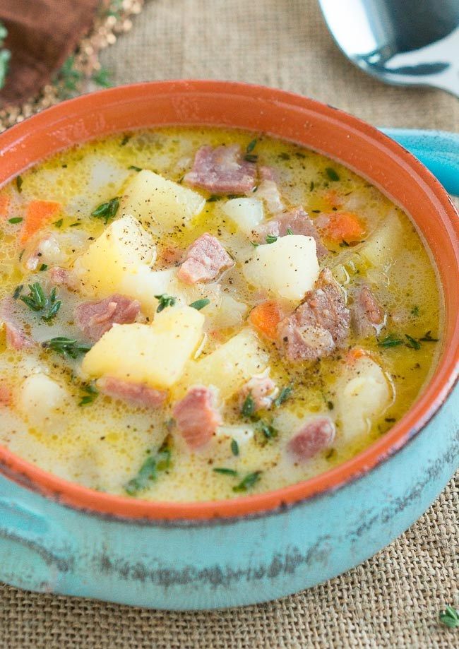 Close of up crock bowl with ham and potato soup