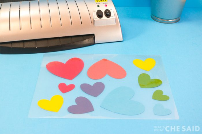 Laminator with letter sized pouch with smaller hearts placed spread out in the letter sized pouch