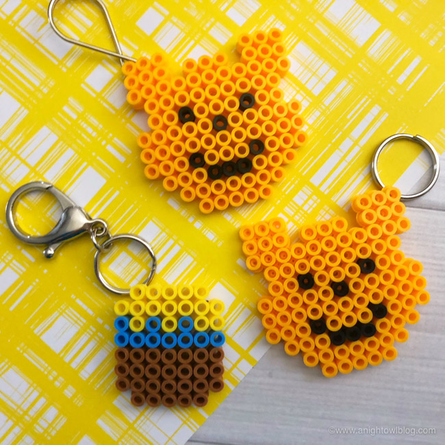Winnie the Pooh and honey pot keychains made from Perler Beads.
