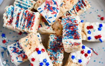 Top down view of Patriotic Rice Krispie Treats stacked on a plate