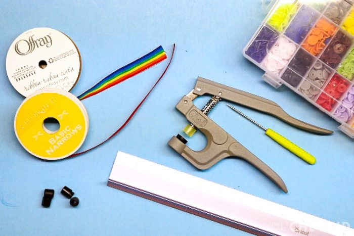 Supplies for DIY Mask Lanyards: Ribbon, safety snaps, ruler, kam snaps, kam press