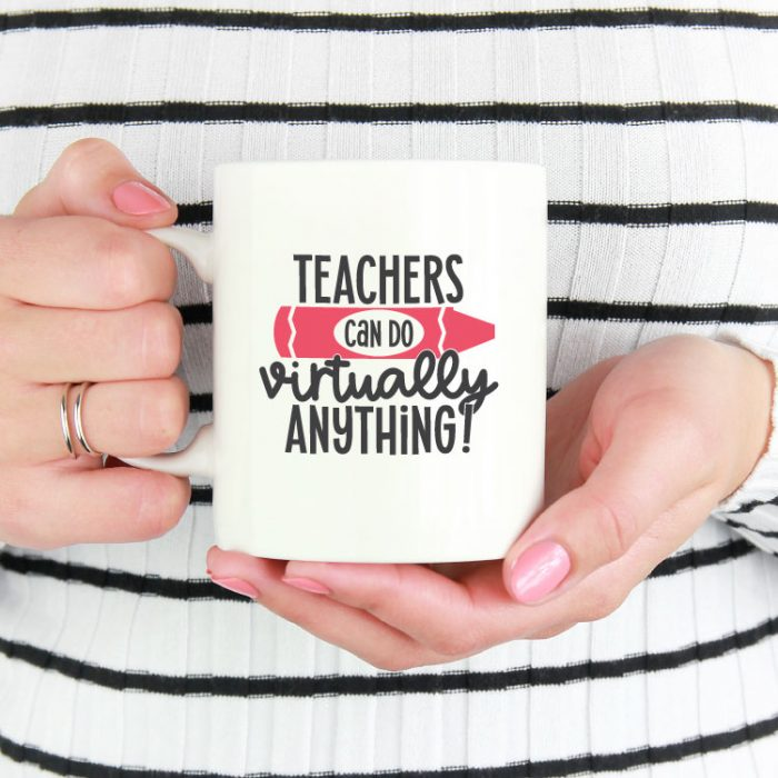 """Woman holding white coffee mug with """"Teacher Can Virtually Do Anything"""" in adhesive vinyl - square format"""