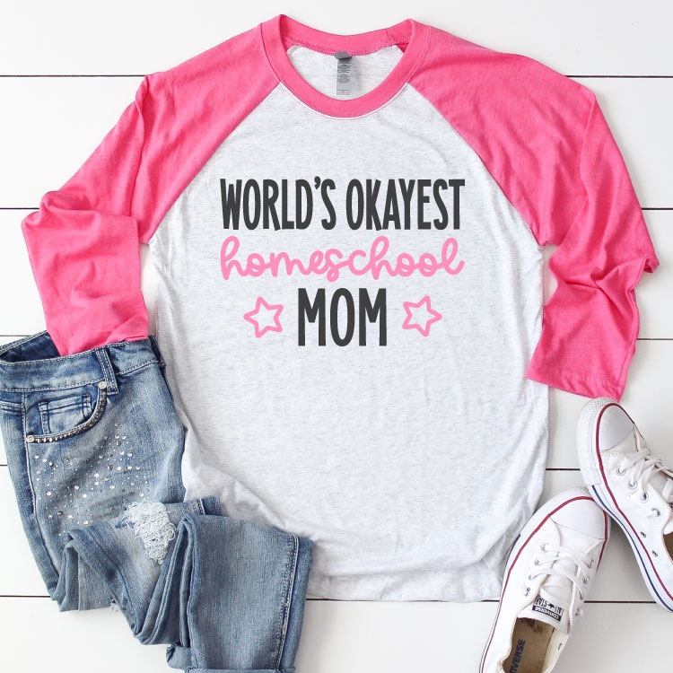 """White Raglan T-shirt with Pink sleeves and jeans and sneakrs. Shirt reads """"World's Okayest Homeschool Mom"""" in iron on vinyl - Square Format"""